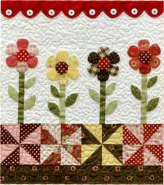 Flower appliqué and pinwheel patchwork.