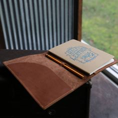 The Inventor PERSONALIZED Fine Leather Journal Padfolio Notebook Cover A5 Moleskine  The Inventor Fine Leather Journal Padfolio is handmade right here in our shop with the finest of Full Grain American leathers. We hand pick our leather hides from a local tannery ~ for a rustic look and