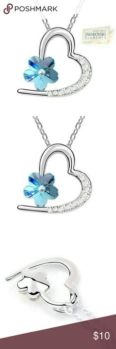 """New Blue Swarovski Flower Heart Pendant Necklace New. Silver open heart pendant adorned with a blue gem flower made of Swarovski crystal elements and crafted in high quality electroplated 18K white gold that adds resistance to tarnish. Adjustable 19"""" inch necklace included.  • Color: Blue/Silver • Metal: 18K White Gold Plated • Item#: NP001 Jewelry Necklaces"""