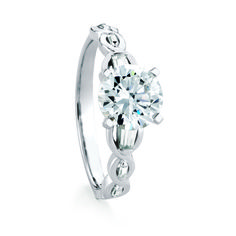 TOBERMORY engagement ring named after the Scottish town of Tobermory. Beautifully flowing Celtic-inspired metalwork flow around graduated baguette diamonds.