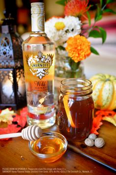 Smirnoff Wild Honey & Ginger Tea Toddy with 2.5 cups tea, 0.5 oz dark rum, 1.0 oz Smirnoff Wild Honey Flavored Vodka, Orange slices, Grated ginger, 1/4 tsp, and ground nutmeg. Combine ingredients in small saucepan over medium heat. Simmer for 15 minutes. Remove from heat, rest for 5 minutes. Remove orange + ginger slices, if you like. Garnish with fresh orange. Serve. #Smirnoff #Fall #drink #recipe