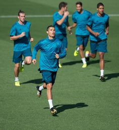 Cristiano Ronaldo Photos Photos - Cristiano Ronaldo of Real Madrid CF warms-up with teammates during the Real Madrid CF training session at Valdebebas training ground on September 12, 2017 in Madrid, Spain. - Real Madrid Training Session