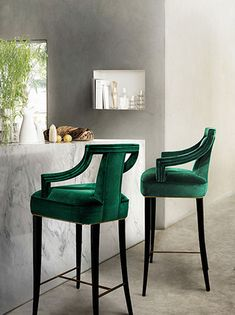 A natural and exotic design fit perfectly in any apartment. These timeless pieces of furniture remind us the wild. The two dark green high chairs are handmade pieces of furniture and have that unique touch. They will fit perfectly in a bar or just for you kitchen décor.