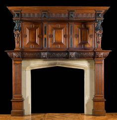 An antique Jacobean style carved oak fireplace mantle.