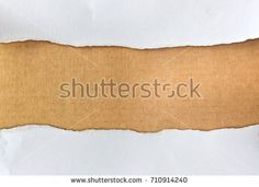 ripped paper on brown cardboard