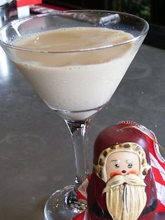 CHRISTMAS COOKIE COCKTAIL 1. Drizzle chocolate sauce on a chilled martini glass. 2. Add 2 oz. White Godiva Vodka, 2 oz. Bailey's Irish Cream, 1/2 oz. Peppermint Schnapps and 1/2 oz. half and half 3. Garnish with a miniature candy cane or chocolate shavings.