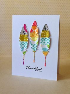 cover cardstock with washi tape, die cut feathers..very clever and ultra cute! three umbrellas: Moxie Fab World--Sticker & Tape Challenge