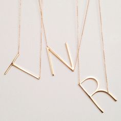 Seriously loving this gold initial necklace.
