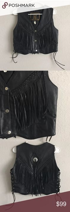 "UNIK Black Leather Fringed Biker Vest Corset AMAZING leather vest in excellent preowned condition!  Beautifully broken in & lightly distressed from wear  Tassel/fringe details with silver concho on back  Braided trim  Adjustable corset-style lace-up sides  2 interior pockets  By Unik  Size Small   MEASUREMENTS:  Chest 36""  Shoulder to Hem (Bottom) 18-1/2""  Shoulder to Shoulder 13""  Waist 35"" Unik Jackets & Coats Vests"