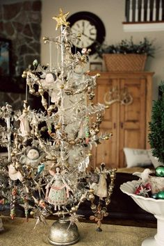 Angel tree in feather white. Delicate tree with Victorian angel decorations in pale pastel colors with tiny glass bead garlands in a pearlized white.