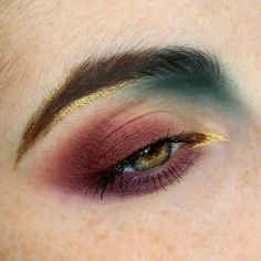 Burgundy, forest green & gold eye makeup.