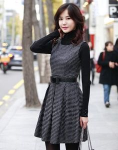 Shirt layered under dress, bow belt, tights, purse