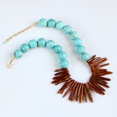 Gold Coral Necklace, Turquoise Necklace, Turquoise Magnesite, Bronze, Copper, Tropical Statement Necklace. $52.00, via Etsy.