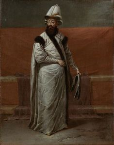 1727-30.De grootvizier Nevşehirli Damat Ĭbrahim Pasa. Rijksmuseum.Ǐbrahim Pasha is gekleed in een witte satijnen kaftan gevoerd met sabelbont en een kallâvî, een ceremoniële tulband waar men de vizieren aan kon herkennen. De grootvizier droeg een gouden band over de tulband ter onderscheid van de vizieren, die een zwarte band droegen. Op de achtergrond zien we de sofa of bank die ook op het tweede audiëntieschilderij in de divan is te zien.Jean Baptiste Vanmour