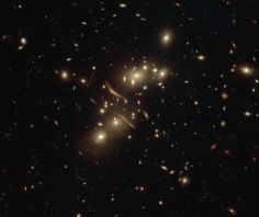 Hubble captured this image of the galaxy cluster Abell 2813 demonstrating spectacularly the concept of gravitational lensing. Einstein, Fotos Do Hubble, Aliens, Nasa Goddard, Nasa Photos, Hubble Images, Hubble Space Telescope, Tips & Tricks, Our Solar System