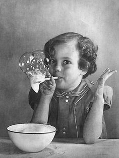 Girl Blowing Soap BubblesBy Gjon Mili Photographic Print: Girl Blowing Soap Bubbles by Gjon M