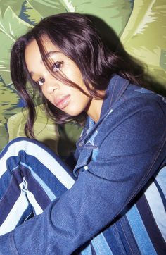 Actress Laura Harrier on Holiday Party Dressing: Denim Striped Jacket and Pants, Tommy Hilfiger; Red Velvet High Heeled Booties, Christian Louboutin | coveteur.com