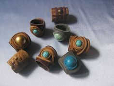 leather rings. (couldn't tell the artist by the pin - just a jpeg.)