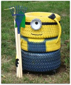 A children's backyard playground despicable me minion made from recycled tyres. DIY, playground, kids, minions, creative ideas.
