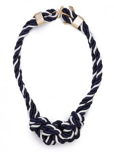 """Even if you don't love knots, you will still love this enchanting rope necklace, and the anchor closure that adds the perfect nautical touch to it. Toggle clasp Cord, plated base metal Length: 16"""""""