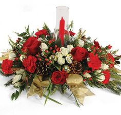 Loaded with holiday spirit, this c#ChristmasCenterpiece features red roses, white spray roses, red carnations, pinecones and berries.