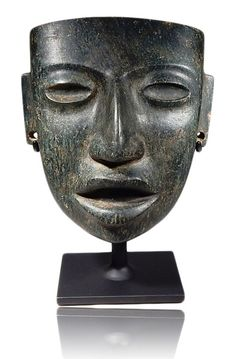 Pre-columbian Serpentine Teotihuacan Mask from Mexico, ca. 450-600 A.D. Exquisitely carved with perfect details. Oval shaped eyes, nice brow ridge with a protruding nose and tab like ears. Each ear perforated, which would of held earrings or earspools. This and more important Ancient Art from the world's best dealers at the curatorseye.com.  #ancientart