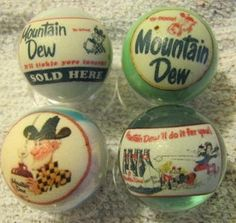 4 MOUNTAIN DEW GLASS ADVERTISEMENT MARBLES 1 INCH SIZE + STANDS !!! | eBay