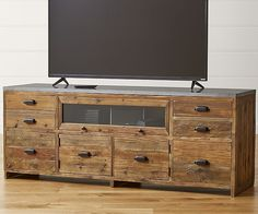 This one-of-a-kind media console extends a warm welcome with its architectural modern farmhouse appeal. Gently weathered reclaimed pine and rugged bluestone cut a clean profile in durable natural materials with an abundance of storage for family rooms and media rooms.