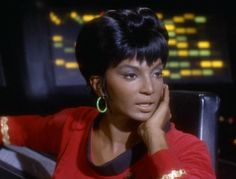 Nichelle Nichols as Uhura in TOS .  I was Uhura when my brother and I 'played' Star Trek!
