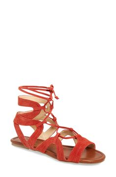 Suede straps in a burnt red wrap the foot on this trend-right sandal fitted with thin, gladiator-inspired laces for a chic update to the everyday style.