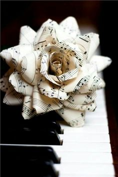 """** site does not work** idea for oragami flower made of music notes for julie or mom's piano studio- I'm sure I could find another pattern for origami. Would be beautiful in a vase with a few """"musical roses""""! Paper Art, Paper Crafts, Diy Crafts, Music Paper, Book Crafts, Sheet Music Crafts, Sheet Music Art, Music Flower, Rose Music"""