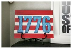 """Use """"glitterized"""" wooden numbers from Hobby Lobby on a painted canvas to create a chic and sparkling piece of patriotic décor! Thanks @eighteen25 for the great idea!"""