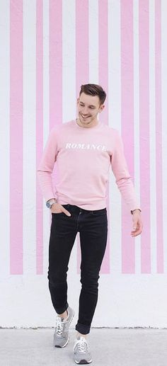 Pink and black are a great color combination for mens style in Spring. Here I paired black slim cut denim from Club Monaco with a Sandro pink graphic sweatshirt that reads Romance with a classic silver Timex watch and finally grey new balance sneakers.