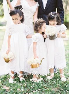 Adorable Flower Girls with White Roses in Vintage Brass Teapots | Marissa Lambert Photography | White Peonies and Floral Lace for a Classic New Orleans Wedding