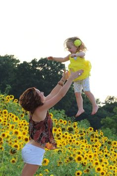 Photography Picture Sunflower Mother Mom Mommy Daughter Girl toddler child family love. ME AND JADEN !! i don't ever see pictures on pinterest of the mom throwing the child in the air. its always the dad.. Being a single mom it only felt right to do it myself. She gives me all my strength.