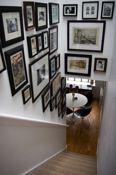 i've had our family portraits and pictures in our stairwell for many years.  two years ago i finally put them all in matte black frames and white mats. it just brought them all together and made it 'picture perfect!'