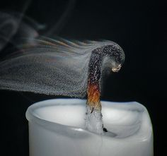 Holy wow. Candle smoke is actually wax..and this guy captured an awesome shot of it, rainbow diffraction and all!!