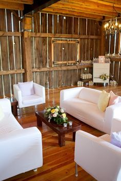 Contemporary reception seating area in a rustic setting.
