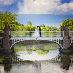 The Bride and Groom meet on the bridge at Helmingham Hall, Suffolk on their Wedding Day. www.headoverheelsphotography.co.uk