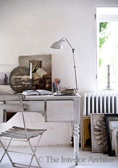 Country house in France designed by London antique dealer Josephine Ryan - Varying shades of white in the office area create a tranquil working environment