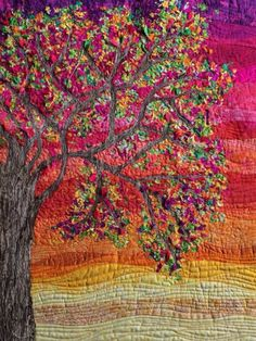 """""""Confetti Tree of My Life Quilt"""". Great quilting. I can't decide whether the textured tree bark is quilted or thread painted. What do you think? I'm leaning towards thread painting."""