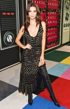 Emily Ratajkowski wears a sequin dress with lace-up boots