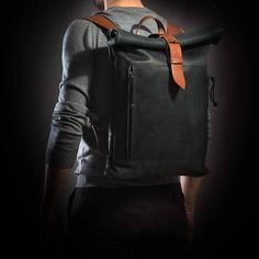 Less is more. This is a minimalist, no fuss, road-ready backpack. With a large compartment and a cell phone pocket inside, you can pack your things quickly and easily. The expandable and contractible roll-top is securely closed with a robust strap and buckle. A pass through
