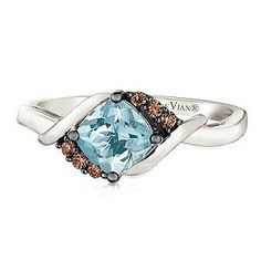 Indulge in the elegant beauty of Chocolate by Petite Le Vian. This stunning ring is crafted from sumptuous 14ct Vanilla Gold, while wrap shoulder detailing embraces a vibrant Sea Blue Aquamarine. Deliciously dazzling Chocolate Diamonds add opulent sparkle for breathtaking beauty and unique, glamorous style.