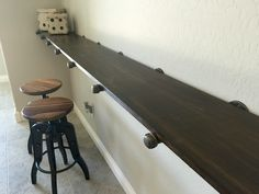 "Idea for bar under projection screen running the whole wall. shelf as a bar with 3/4"" pipe pieces with stained poplar"