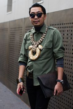 On the Street taken by The Sartorialist - Dude, you GO with your big jewelry and clutch.  LOVE it.