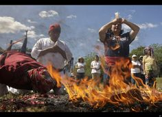 Mayan priests make offerings during an indigenous ceremony commemorating the winter solstice at the ceremonial center of San Andres, in San Andres, El Salvador, Sunday Dec 18. 2011. The winter solstice falls on Thursday Dec. 22. (AP Photo/Luis Romero)