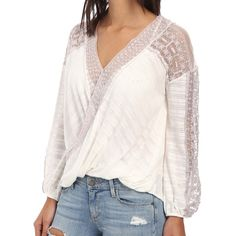 "Free People Valley City Top XS NWT White flowy top with mauve lace detailing. Pair with bell bottom jeans and leather sandals and you're set!  Fiber Content: 41% cotton/31% rayon/28% polyester    Fit is true to size. Measurements: bust 32"", waist 25"", hips 34"".  No Trades Free People Tops"