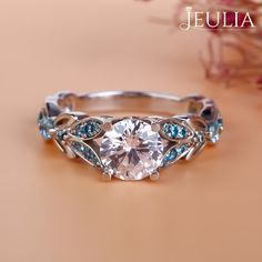 Breathtaking Princess Cut Engagement Rings ❤ Find Your Unique Designer Rings. Be Different. Be Unique. Gorgeous inlay engagement rings, handmade in the US, made just for you. Choose your inlay stone, metal and diamond for a truly unique look. Jeulia Butterfly Round Cut Created White Sapphire with Aquamarine Sidestone Engagement Ring | The Jeulia Jewelry #JeuliaJewelry #engagementringsforwomen
