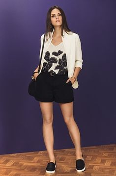 white blazer + white and black shirt + black shorts + black purse + black and white slip on sneakers